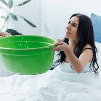 depositphotos_243167128-stock-photo-upset-girl-bed-dealing-water